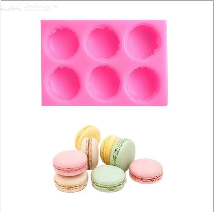 Macaron shapes a silicone mold for a chocolate mousse cake with sugar and cream