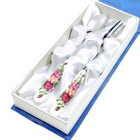Elegant Stainless Steel Fork and Spoon Set with White Ceramic Handles in a Blue Gift Box