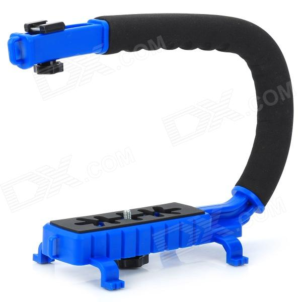 C Type Handle Mount for Camera / DV - Black + Blue - DX - DXMounting Accessories<br>Qty 1 piece(s) per pack Color Blue + black Material ABS + rubber + sponge + aluminum alloy Socket Size 1/4  Max Load N/A kg Max Height 21 cm Min Height 21 cm Other Features Improve stability and versatility of all video and cameras; Great for action shots crowd shots or hard to reach angles; With non-slip mat at the bottom achieving stable shooting; A soft polymer grip can add comfort and ease the long shot fatigue; Constructed from durable ABS plastic; 4/1 inside thread can install on tripod; Packing List 1 x Mount<br>