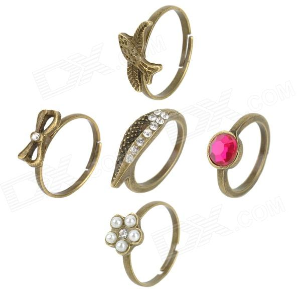 Womens Zinc Alloy Wing / Rhinestone / Bow / Swallow / Flower Style Ring Set (5 PCS)Rings<br>Form ColorCinnamonBrandN/AModelN/AQuantity1 DX.PCM.Model.AttributeModel.UnitShade Of ColorGoldMaterialZinc alloyGenderWomenSuitable forAdultsU.S Size6Ring Diameter1.6 DX.PCM.Model.AttributeModel.UnitRing Circumference5 DX.PCM.Model.AttributeModel.UnitU.S Size 6Packing List1 x Wings style ring1 x Rhinestone style ring1 x Bow style ring1 x Swallow style ring1 x Flower style ring<br>