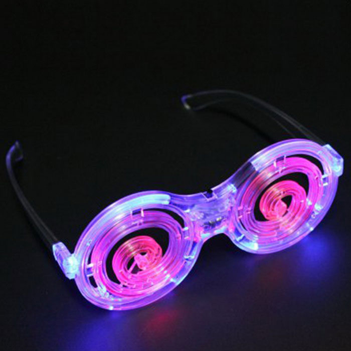 Creative Malt Ring LED Flashing Circular Plastic Glasses - TransparentGoggles<br>Form  ColorTransparentSizeOthersQuantity1 DX.PCM.Model.AttributeModel.UnitMaterialPlasticPacking List1 * Glasses(3*AG3 battery is not equipped)<br>
