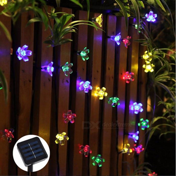 50-LED 7m Peach Sakura Flower Solar Powered LED String Fairy Lights for Outdoor Garlands Garden Christmas Decoration Warm WhiteSolar Lamps<br>Description<br><br><br><br><br>Power Source: Solar<br><br><br>Solar Cell Type: Ni-MH<br><br><br><br><br>Protection Level: IP65<br><br><br>Voltage: 6V<br><br><br><br><br>Usage: Holiday<br><br><br>Certification: RoHS<br><br><br><br><br>Body Material: ABS<br><br><br>Light Source: LED Bulbs<br><br><br><br><br>Base Type: Wedge<br><br><br>Is Bulbs Included: Yes<br><br><br><br><br>Is Dimmable: No<br><br><br>Style: Art Deco<br><br><br><br><br>Brand Name: aurobear<br><br><br><br><br><br><br><br><br><br><br><br>Please note, Red color in the option is Purple<br><br>Features<br>1. 50 LEDs,total 7m<br>2. leader wire is 2m,the wire with leds is 5m<br>3. LED color: White / Blue / Warm White / Purple / Multi-color(Yellow,White,Blue,Green)<br>4. Material: ABS plastic<br>5. Solar panel:2V/100MA,400mAh 1.2V Ni-MH battery(Included)<br>6. The light will work of itself when the environment brightness is less than 20 Lux<br>7. It can work abut 8-10 hours after being charged fully in the day<br>8. It is waterproof,you can put it outdorr in the rain,but DONT put it underwater<br><br>Package included<br>1x&amp;nbsp; one led string 50leds<br>