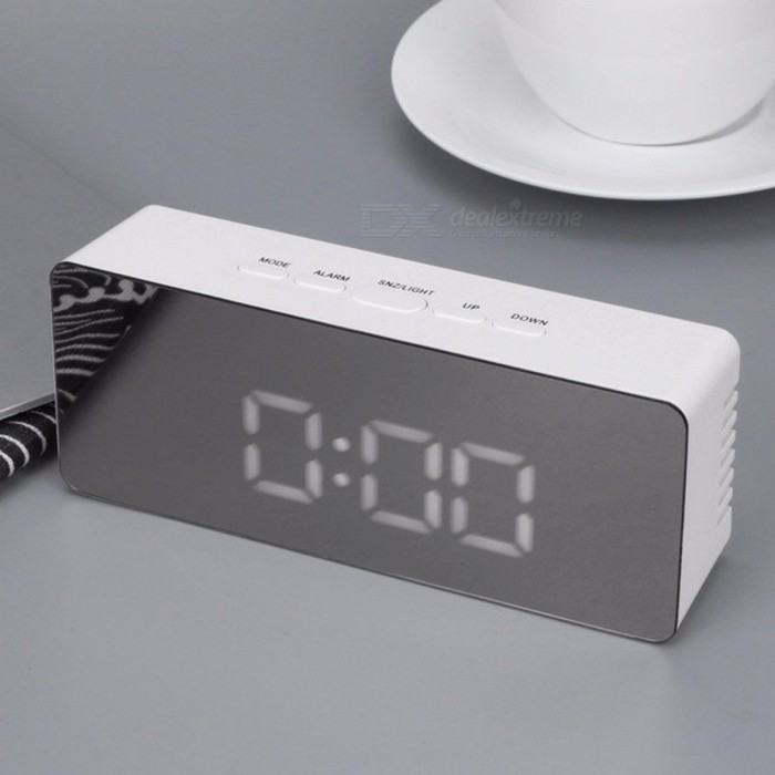 Multifunction LED Alarm Clock Digital Electronic LED Mirror Clock Temperature Snooze Large Display Home Decor Mirror Function Mirror Clockdesk clock<br>Description<br><br><br><br><br>Type: Alarm Clocks<br><br><br>Style: Modern<br><br><br><br><br>Shape: Square<br><br><br>Screen Type: LED<br><br><br><br><br>Brand Name: JOCESTYLE<br><br><br>Function: Snooze Function<br><br><br><br><br>Motivity Type: Digital<br><br><br>Display Type: Digital<br><br><br><br><br>Material: Plastic<br><br><br>Form: Single Face<br><br><br><br><br>Feature: LUMINOVA<br><br><br><br><br><br><br><br><br><br><br><br><br><br><br><br>Feature: LUMINOVA <br><br><br>Length: 145mm <br><br><br>Weight: 122g <br><br><br>Power input: : DC 5V <br><br><br>Product size: : Approx. 140*55*35mm <br><br><br>Material: : ABS <br><br><br>Net weight:: Approx. 122g <br><br><br>Features: <br>1. LED time display <br>2. 12/24 hour format selectable <br>3. Alarm and snooze <br>4. Temperature range: 0?~50? <br>5. Night mode setting (18:00-06:00) <br>6. Mirror function <br>7. Time and Temperature switch display <br>8. 2 light luminescence level <br>9. Five function button (MODE, ALARM, SNZ/LIGHT, UP,DOWN) <br>10. Time memory function (3 x AAA batteries for time memory) <br>11. Power supply: 3 x AAA Batteries (NOT Included)&amp;nbsp; <br>&amp;nbsp; &amp;nbsp; &amp;nbsp; &amp;nbsp; &amp;nbsp; &amp;nbsp; &amp;nbsp; &amp;nbsp; &amp;nbsp; &amp;nbsp; &amp;nbsp; &amp;nbsp; &amp;nbsp; &amp;nbsp; &amp;nbsp;USB Charging Cable <br><br>Specification: <br>Name: LED Mirror Clock <br>Model: TS-S69 <br>Material: ABS <br>Power input: DC 5V<br><br><br><br><br><br><br><br>Packing List:<br><br><br>1 x LED Mirror Clock <br>1 x USB Charging Cable<br>1 x User Manual (English)<br>