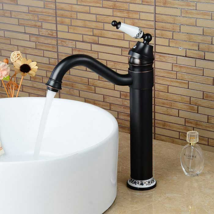 F-0729 Antique Oil-rubbed Bronze Ceramics Handle Bathroom Sink FaucetBath Faucets<br>Form  ColorBlack+WhiteModelF-0729MaterialBronzeQuantity1 DX.PCM.Model.AttributeModel.UnitFinishOthers,Oil-rubbed BronzeFaucet Spout MaterialBrassFaucet Body MaterialBrassFaucet Handle MaterialZinc AlloyStyleAntiqueOther Features- Installation type: Centerset; <br>- With single hole; <br>- With one switch; <br>- Ceramic valve; <br>- Support cold / hot water switch; <br>- Standard 1/2 threads; <br>- Water outlet length: 20cm; <br>- Water outlet height: 24cm.Packing List1*Faucet2*Stainless steel tubes (50cm)2*Seal rings1*Screw nut<br>