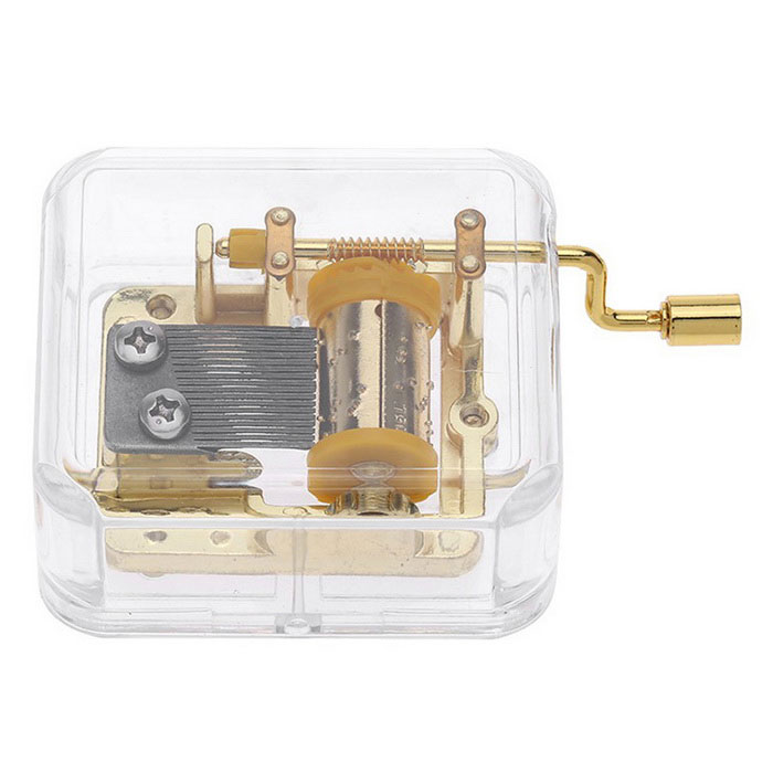 Unique Musical Box Acrylic Hand Crank Movement Melody Music Box - GoldInstruments Parts<br>Form  ColorGolden + Transparen (Kiss The Rain)MaterialAcrylic + metalQuantity1 DX.PCM.Model.AttributeModel.UnitShade Of ColorTransparentCompatible ModelsN/AOther FeaturesItem Name: Hand crank acrylic music box<br>Material: Acryl and metal<br>Melody: Kiss The Rain<br>Shape: Cubic<br>Rhythm: 18 notesPacking List1 * Music box<br>