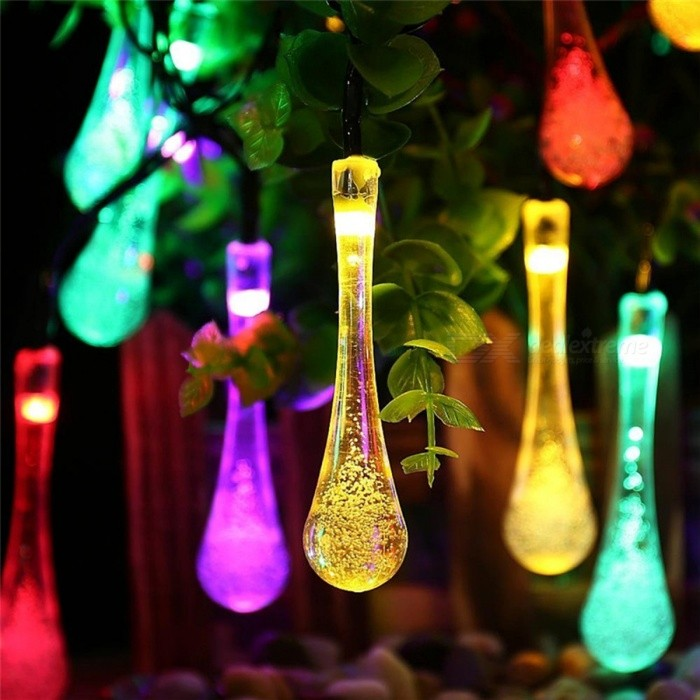 Water Droplets Style Multi-Color Light Solar Fairy String Light (6m)LED String<br>Form  ColorTransparent + BlackColor BINMulti-colorMaterialPVCQuantity1 DX.PCM.Model.AttributeModel.UnitPower6WRated VoltageOthers,N/A DX.PCM.Model.AttributeModel.UnitEmitter TypeLEDTotal Emitters30WavelengthN/AActual LumensN/A DX.PCM.Model.AttributeModel.UnitPower AdapterSolar PoweredPacking List1 x Solar Panel with stand 1 x 30-LED Solar light1 x Product specification<br>